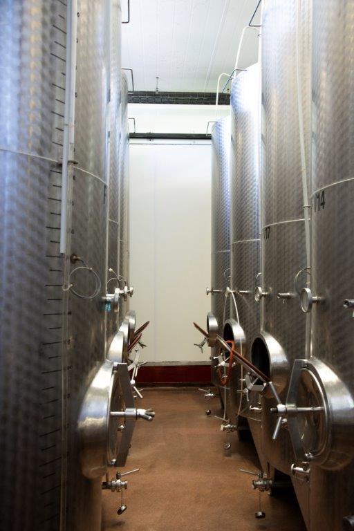Stainless steel wine fermentation tanks at Three Choirs Vineyards